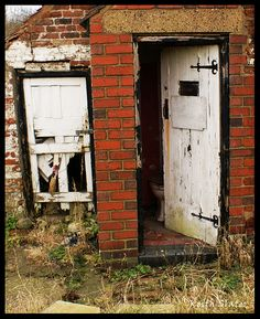 Brick with weathered door ... outhouse   Photo by Keith Slater
