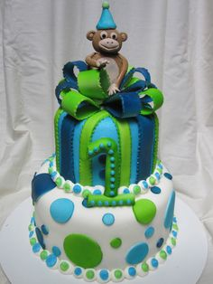 https://flic.kr/p/a2Y4Xg | First birthday boy cake | First birthday boy cake with lime green, light blue and dark blue polka dots and present second tier with bow and little monkey on top.