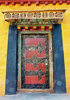 Red Door with ornate designs in Tibet Cool Doors, Unique Doors, The Doors, Windows And Doors, Portal, Porte Cochere, When One Door Closes, Knobs And Knockers, Door Gate