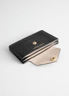 """Cardholder in textured-leather.""""Paris Atelier"""" snap button closureLogo printed in gold insideDimensions: x 7 x Leather Business Card Holder, Leather Card Wallet, Leather Keychain, Leather Accessories, Handbag Accessories, Credit Card Wallet, Black Wallet, Small Leather Goods, Cow Leather"""