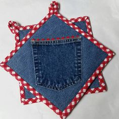 Denim pocket hot pads with red gingham. Pocket is usable, add a recipe or some kitchen utensils to the pocket and use for a hostess gift. Made from recycled materials except the batting. Batting is Insul-Bright needled insulated lining. Not to be used in a microwave.  I have a set of these and love them, they wash up beautiful. Definitely go along with the theme of my shop Grannys Recyced Rags, Upcycling at its best! Size 8 X 8 square Comes in a set of two.  Will ship Usps First Class Mail…