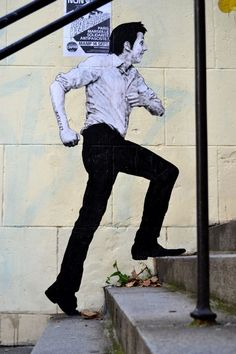 Stairs by Levalet Street art graffiti collage in Paris