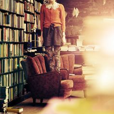 Standing in a bookshop by Holunder.deviantart.com on @deviantART