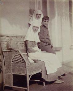 Tatiana, Olga and Alexei on Alexandra's Balcony at Alexander Palace, c. 1915
