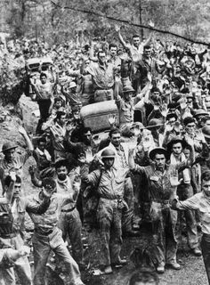 American and Philippine troops hold up their hands in surrender, as they are rounded up by the Japanese in Bataan, the Philippine Islands. (Photo by Keystone/Getty Images)