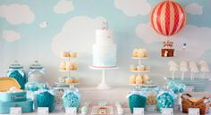 Our heads are in the clouds today with this sweet Hot Air Balloon themed dessert table that was styled by Belinda fromStyled By Belle for a little boy's christening. Belinda chose a soft blue & white color palette with pops of red to bring in the red hot air balloon. Sweet treats on the dessert …
