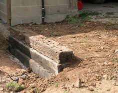If you have a slope that is need of a retaining wall and have access to railroad ties, this is the perfect project for you! We'll be showing you how ...