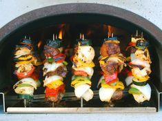 Recipes for cooking in a wood-fired brick oven.