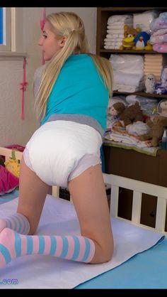 Teen girl in wet diaper