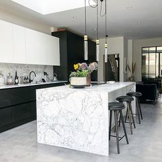 We love this industrial looking kitchen with the marble waterfall island unit m. - We love this industrial looking kitchen with the marble waterfall island unit matt black cabinets - Marbel Kitchen, Concrete Kitchen Floor, Black Kitchen Cabinets, Kitchen Flooring, Marble Kitchen Ideas, White Cabinets, Open Plan Kitchen Living Room, Home Decor Kitchen, Luxury Kitchen Design