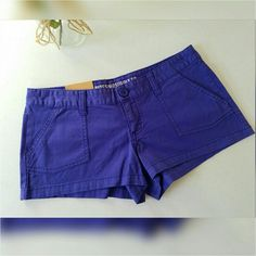 Tuesday Sale Item...Low waisted shorts Purple shorts never worn with tags. 98% cotton and 2% spandex. 2.5 inseam. Size chart in last photo. Make an offer loves. Mossimo Supply Co Shorts
