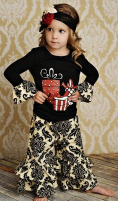 Ok so the tee does nothing for me because, seriously, black for xmas on a kid is just SAD - but I love the over-the-top ruffles and flapper headband, so quirky!!