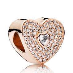 With its shimmering look and romantic heart shape in a blush pink color, this adorable cubic zirconia encrusted charm is the perfect choice for sharing your loving feelings with the sweetheart in your life.<br><br><i>Luminous and elegant, PANDORA Rose™ jewelry combines a unique blend of metals to capture new and unforgettable moments in warm pink-hues.</i><br> <br> <b> Style: </b> 781555CZ