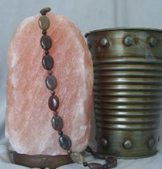 "22"" Picasso Jasper and Rhodonite with silver plated lobster claw closure Beautiful, protecting Jasper is said to help to relieve repressed negative energy and promote calm.  Rhodonite nurtures love and balances emotions.  The warm earth tones and the coolness of the stones look and feel wonderful!"