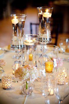 elegant glass candle and flower decor at wedding reception #elegantwedding #tabledecor #weddingchicks http://www.weddingchicks.com/2014/01/30/pink-and-peach-bejeweled-wedding/