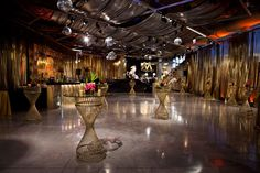 To bring a Studio-54 vibe into the Greektown store, Kehoe Designs brought in gold drapes, shimmering bars, and disco balls. Photo: Liliane Calfee
