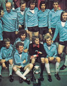 18th June 1972. West German players sitting with the Nations Cup trophy following a 2-0 victory over USSR, in Belgium.