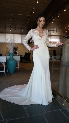 Long sleeve wedding dress with lace sleeves. by Chantel Lauren.