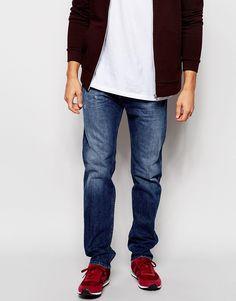 Jeans von Diesel Baumwoll-Denim Abnutzungserscheinungen normale Bundhöhe geknöpfter Schlitz schmale Passform, sitzt eng am Körper Maschinenwäsche 100% Baumwolle unser Model trägt Größe 81 cm/32 Zoll und ist 185,5 cm/6 Fuß 1 Zoll groß