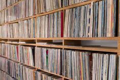 John Peel's Record Shelf. Wonderful site design, gives you access to the record collection of the legendary radio DJ.