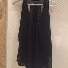 Black chiffon Top Cliche flowy Black Chiffon top... Halter ... With strip on back and transparent.. Great to use with leggings... Cliche Tops Blouses