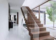 Pasillo, hall y escaleras de estilo por HomeKONCEPT   Projekty Domów Nowoczesnych