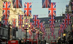 union jack flags hanging in london's regent street to mark the royal wedding