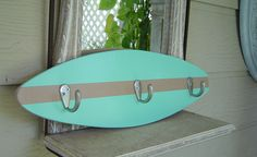 18 inch SURFBOARD HOOK RACK. Beach Sea and Tan. Hang towels clothes keys jewelry.  Hawaiian Surf Wall Decor.150 Designs and 3 sizes. wow. $69.99, via Etsy.