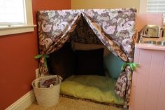 A reading nook or take-apart fort made with a PVC frame and fabric cover.