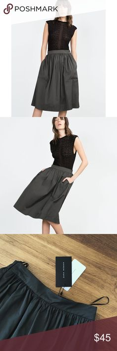 "NWT Zara High Waist Pocket Midi Skirt Size 0/2 XS Brand new with tags. Thicker sturdy material, similar to nylon. Can't find the materials tag or else I'd confirm. Probably poly blend. Definitely a non-snagging slippery like material. Smoke free pet friendly no flaws.   Waist 24"" Length 27.5-28"" Zara Skirts Midi"