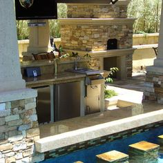 Outdoor fireplace with pizza oven. Love homemade pizza & a great way to make dinner as a family. Plus, the swim up bar is fantastic, and of course a salt water pool.
