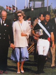 May 24, 1984: Prince Charles and Princess Diana with Ronald Ferguson (next to Princess Diana) at a polo match at Smith's Lawn, Windsor.: