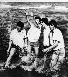 THE BEATLES, 1964. The Beatles playing in Lake Erie during a trip to Cleveland, Ohio to play a concert, 1964. Left to right: John Lennon, Paul McCartney, George Harrison and Ringo Starr.