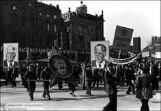 This is a photograph of May Day on May 1st 1951 in east germany. This day had always been a day of protest in germany since 1890 and was preserved as a national holiday. The protestors are holding portraits of Pieck, Stalin, and Grotewohl. This is a drastic change from just 6 years ago when the right to protest and defy the government was taken away.