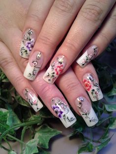 Fit for a bride. White tips with a floral design.