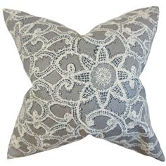 Refined tones of platinum and white intertwine in this stylish throw pillow, creating a floral pattern that gives your decor a charming upgrade. This reversible Brinley design is filled with down and feathers for a plush feel.