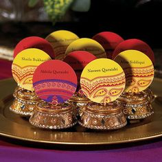 Apply these Indian theme stickers to your wedding favor boxes or place or favor thank you cards to add your personal touch. Repeating names and dates only can be personalized. Multiple name place cards (as shown in the picture) are not available. Colors as shown only.Minimum Order of 36 stickers