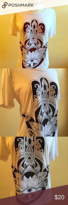 """FLASH SALE Hamsa Evil Eye Lotus Loose Fit Tee L XL Brand new, graphic tee with Hamsa image on the front. Short sleeves and has a round neck. Has a loose type fit so can be worn by a variety of sizes. Never worn. Measures 36"""" across and 32"""" at waist Boutique Tops Tees - Short Sleeve"""