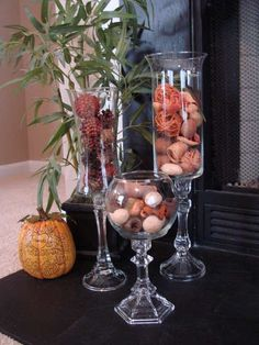 Hurricane vases are wonderful in and of themselves but they can make especially beautiful centerpieces. The often are seen holding larger Large Pillar Candles, Diy Candles, Beeswax Candles, Decoration Evenementielle, Diy Party Decorations, Candle Decorations, Dollar Tree Decor, Dollar Tree Crafts, Dollar Tree Vases