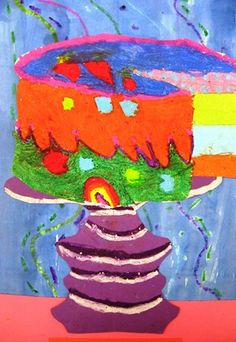 Second Grade Students created theses great Wayne Thiebaud inspired cakes by drawing a cylinder and learning to cut out a slice using parallel lines. The artwork was colored with oil pastels. Next, students make a symmetrical cake plate. Our backgrounds were made by making line designs with oil pastel and painting over it with watercolor paint. The oil pastel creates a resist. The students achieved a relief, or popped-out cake with 3-D O's.