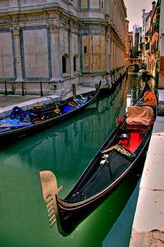 A Black Gondola along the Canal in Venice, Italy