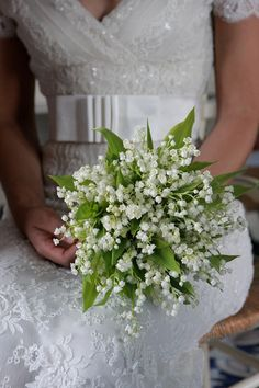 lily of the valley Bouquet idea, maybe with rounder and more green leaves but small white flowers is good...