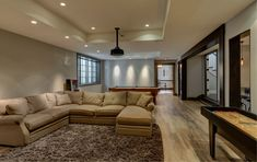 This basement was built for a party! With a custom built wet bar, multiple wine storage racks, game room and more - this is the basement hosts dream of. Start your party planning for a new basement remodel with FBC Remodel today. Finished Basement Company, Living Area, Living Spaces, Wine Rack Storage, Modern Basement, Decor Room, Home Decor, Scenery Wallpaper, Anime Scenery