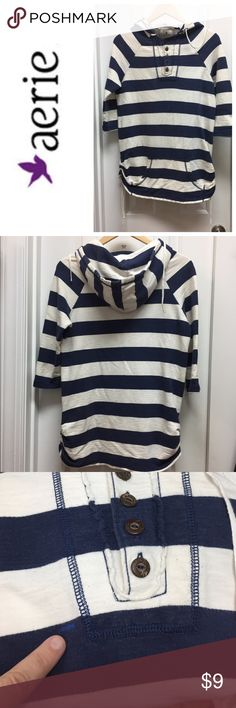 Aerie 3/4 Sleeve Striped Hoodie AERIE  navy stripped hoodie with 3/4 sleeves , 4 buttons down the front , drawstrings on the side. Pocket in front. Worn with love ❤️, only imperfection is a slight blue mark as noted in pic, which is hardly noticeable. Make me an offer , my daughter would like to clean out her closet and earn a few bucks. aerie Tops Sweatshirts & Hoodies