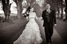 Comlongon Castle Hotel, Scotland: B photo of bride and groom walking down a tree-lined path #wedding #destinationwedding