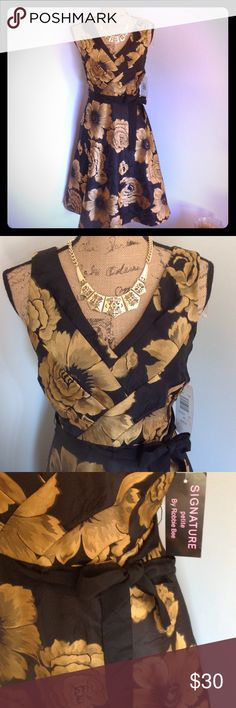 "Signature petite by Robbie Bee Dress Black and gold dress by Robbie Bee. NWT Petite collection. Size 8p. Ties at waist. Polyester. Length is 40"" bust is 36"" waist is 32"" Robbie Bee Dresses Midi"