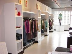 TASTE - clothing displays toward front of store by Graystone-Inc, via Flickr