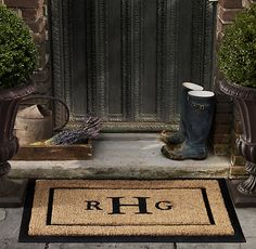 Create your own door mat with a vinyl stencil and spray paint. LOVE!