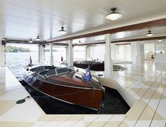 Boathouse in the house!!!....with garage doors!!... and harlequin painted floors! Beautiful....