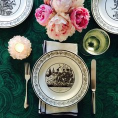 "And in focusing on the table, feel free to deviate from the standard red-and-green. ""Rather than the traditional red and green scheme, try something new like a fabric in malachite and hot pink peonies,"" says designer Grant Gibson. ""Layer in black and white for a graphic pop. The plates [here] are antique French."""